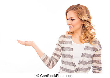 Happy young woman showing product on white background