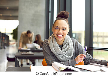 Cheerful young student preparing for final exams - Happy ...