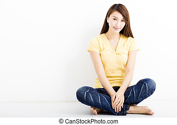 happy young woman sitting on the floor