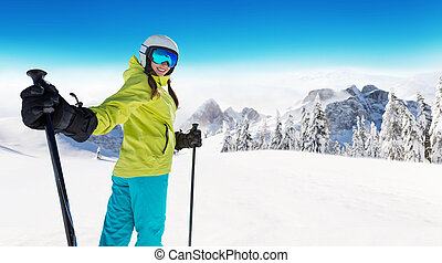 Happy young woman skier enjoying sunny weather in Alps....