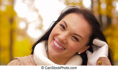 happy young woman smiling in autumn park