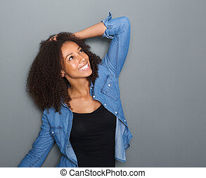 Happy young woman smiling with hand in hair