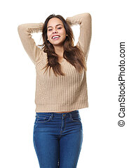 Happy young woman smiling with hands in hair