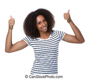 Happy young woman smiling with thumbs up