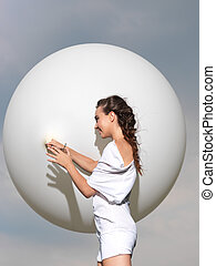 happy young woman standing with white balloon