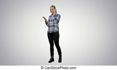 Happy young woman talking on mobile phone smiling on white background.