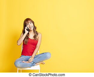 happy young woman talking on phone