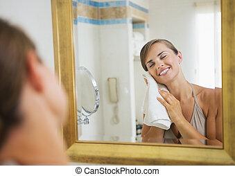 Happy young woman towel in bathroom