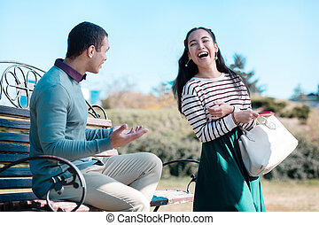 Happy young woman walking in park with friend