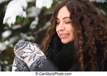 Happy young woman walking in winter time.
