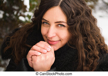 Happy young woman walking in winter time