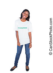 Happy young woman wearing volunteer tshirt on white...