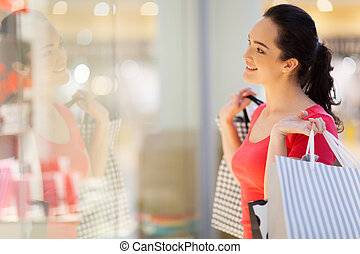 happy young woman window shopping
