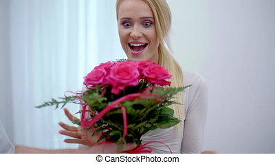 Happy young woman with a bouquet of flowers