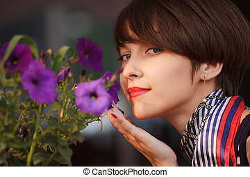 Happy young woman with a flowers