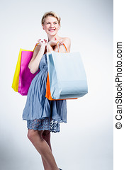 Happy young woman with bags
