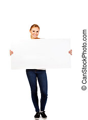 Happy young woman with blank billboard