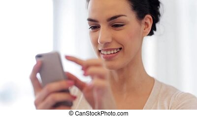 happy young woman  with braces and smartphone