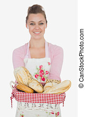 Happy young woman with bread basket