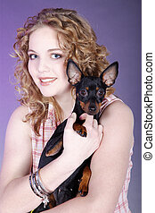 happy young woman with dog