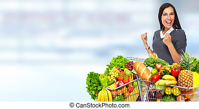 Happy young woman with grocery shopping cart. - Happy young...