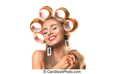 Happy young woman with hair curlers on her head isolated on white.
