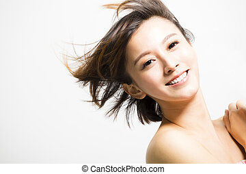happy young Woman with hair motion