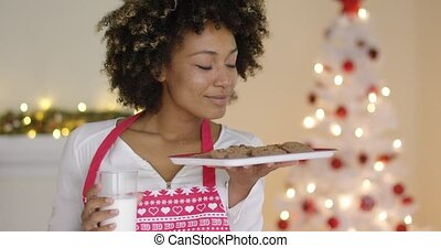Happy young woman with milk and cookies for Santa - Happy...