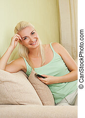 Happy young woman with mobile phone