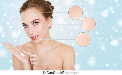 happy young woman with moisturizing cream on hand