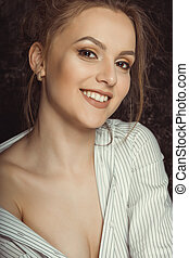 Happy young woman with natural makeup in striped shirt