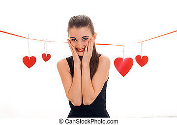 happy young woman with red lips celebrating valentines day with hearts isolated on white background