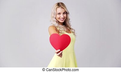 happy young woman with red paper heart - love, romance,...