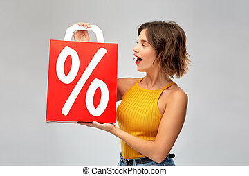happy young woman with shopping bag on sale
