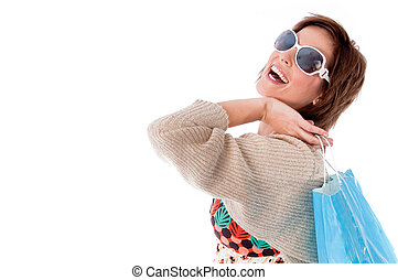 Happy young woman with shopping bags on white