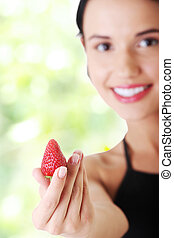 Happy young woman with strawberry.