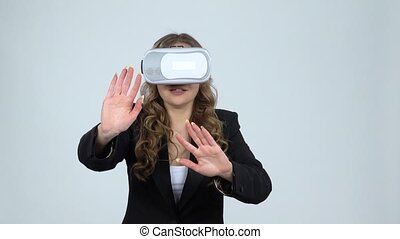 Happy young woman with virtual reality headset or 3d...