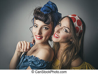 Happy young women in retro style clothing