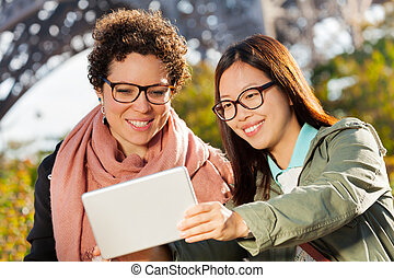 Happy young women taking selfie photo with tablet