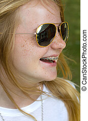 happy youngster - laughing young girl with teeth braces and...