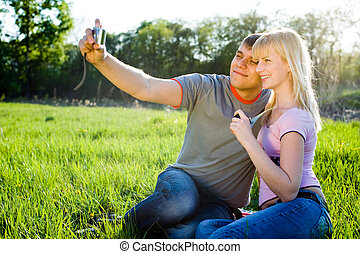 Happiness couple in love with digital camera smiling