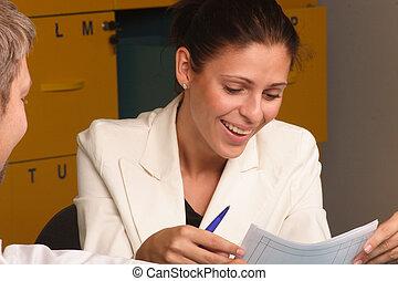 smiling secretary - Happy,smiling secretary, talking to a...