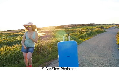 Hapy young woman with suitcase. Travel concept