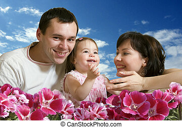 Hapyy family and blue skies - Happy family - mother, father...