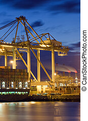 Harbor activity - The unloaing of a cargo vessel using huge...