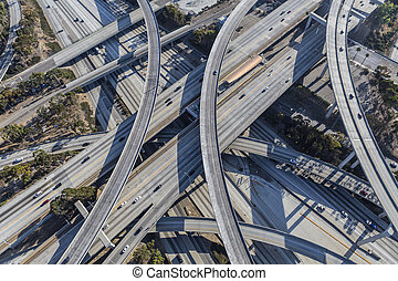 Harbor 110 and Century 105 freeway interchange aerial south of downtown Los Angeles in southern California.