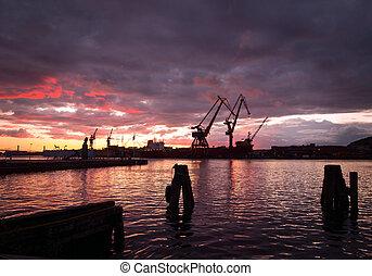 Eevning view of harbor area with cranes