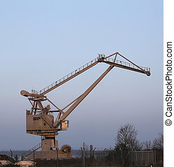 Harbor Crane - Gray crane in a harbor.