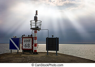 Harbor entrance beacon - Signs and radio beacon at the end...