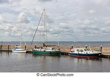 Harbor historic Dutch village Urk with modern sailing yachts